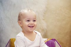baby boy playing in a cardboard box at home stock images