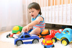Baby boy playing cars stock photos