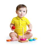 Baby boy playing with colorful toy Stock Photo