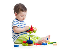 Baby boy playing construction set Stock Images