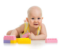Baby boy playing with construction set over white background Stock Photography
