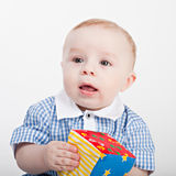 Baby boy playing with a cube Stock Photography