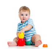 Baby boy playing with cup toys over white Royalty Free Stock Photos
