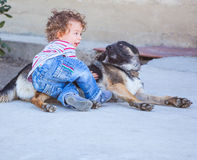 Baby boy playing with a dog Royalty Free Stock Photo