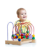 Baby boy playing with educational toy royalty free stock photography