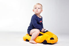 Baby boy is  playing with educational toys Stock Images