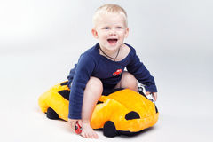 Baby boy is  playing with educational toys Stock Image