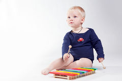 Baby boy is  playing with educational toys Royalty Free Stock Photo