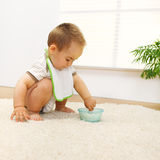 Baby boy playing with food Royalty Free Stock Images
