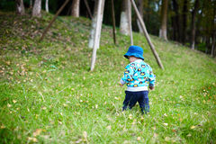 Baby boy playing on grass Royalty Free Stock Photography