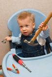 Baby boy playing with hammer Stock Image