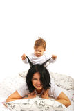 Baby boy playing with her mother hair Royalty Free Stock Photos