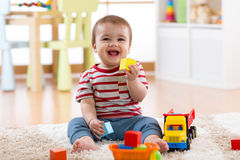 Baby boy playing with his colorful toys Royalty Free Stock Image