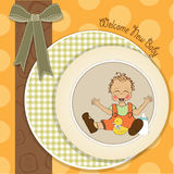 Baby boy playing with his duck toy, welcome baby card Stock Images