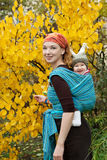 Baby boy  playing with his mother in autumn garden Royalty Free Stock Photo