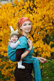 Baby boy  playing with his mother in autumn garden Stock Images