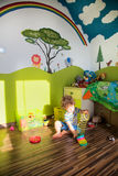 Baby boy playing in his room Royalty Free Stock Photo