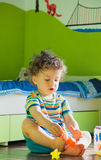 Baby boy playing in his room Royalty Free Stock Photos