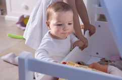 Baby boy playing with his sister at toys room Royalty Free Stock Image