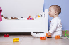 Baby boy playing with his toy trunk Stock Photography