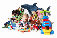 Baby boy playing with his toys royalty free stock photos