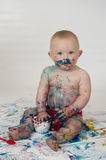 Baby boy playing with homemade fingerpaints Royalty Free Stock Photography