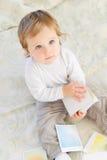 Baby boy playing indoors Stock Image