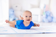 Baby boy playing and learning to crawl Royalty Free Stock Photography
