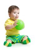 Baby boy playing with massage ball Royalty Free Stock Photo