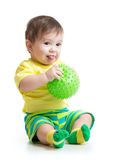 Baby boy playing with massage ball Stock Images