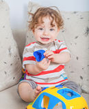 Baby boy playing. 11 months old baby boy portrait playing with a toy car Stock Photography
