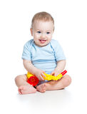 Baby boy playing musical toy Stock Photo