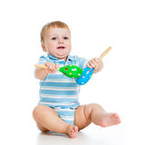 Baby boy playing with musical toys Stock Photos