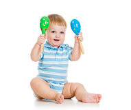 Baby boy playing with musical toys on white Stock Images