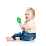 Baby boy playing with musical toys on white backgroun Royalty Free Stock Photo