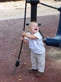 Baby boy playing in park. Blond baby boy playing in park with a wire Royalty Free Stock Images