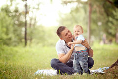 Baby boy playing in the park with dad. Little boy playing in the park with dad stock photography