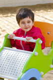 Baby boy playing at park with little car Royalty Free Stock Photo