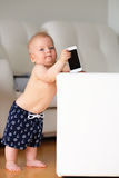 Baby boy playing with phone Stock Photography