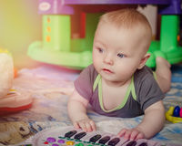 Baby boy playing with piano toy Stock Images
