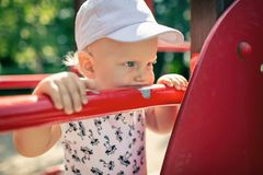 Baby boy playing in playground alone. Royalty Free Stock Images