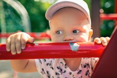 Baby boy playing in playground alone. Stock Image