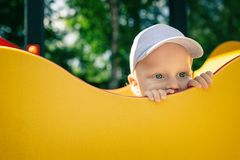 Baby boy playing in playground alone. Royalty Free Stock Image