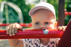 Baby boy playing in playground alone. Stock Images