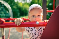 Baby boy playing in playground alone. Royalty Free Stock Photos