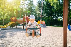 Baby boy playing in playground having fun Royalty Free Stock Photos