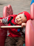 Baby boy playing on a  playground equipment Royalty Free Stock Photo