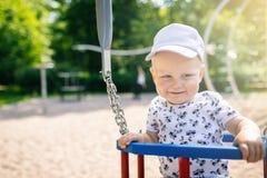 Baby boy playing in playground having fun Stock Photos