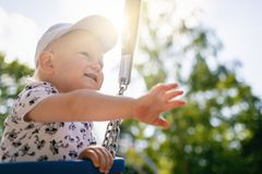 Baby boy playing in playground having fun Royalty Free Stock Photography