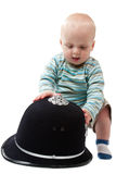 Baby Boy Playing with Police Helmet Stock Image